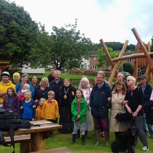 group of people in new children's park
